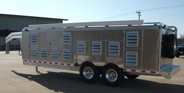 Tandem axle gooseneck dog trailer. It has 22 crates for dogs and 8 storage  compartments.
